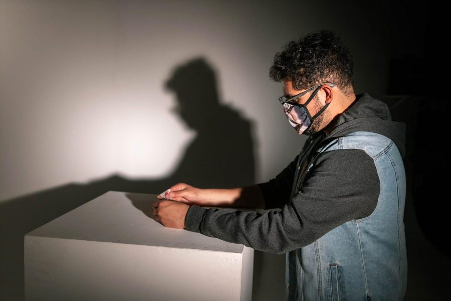 Daniel Rodríguez adjusts a prop Saturday, April 10, 2021 at SIU. Rodríguez is a MFA student in the department of Mass Communications and Media Arts. The video he created included people from Columbia, Peru, Mexico, Costa Rica, Brazil, Honduras, Venezuela, and El Salvador.
