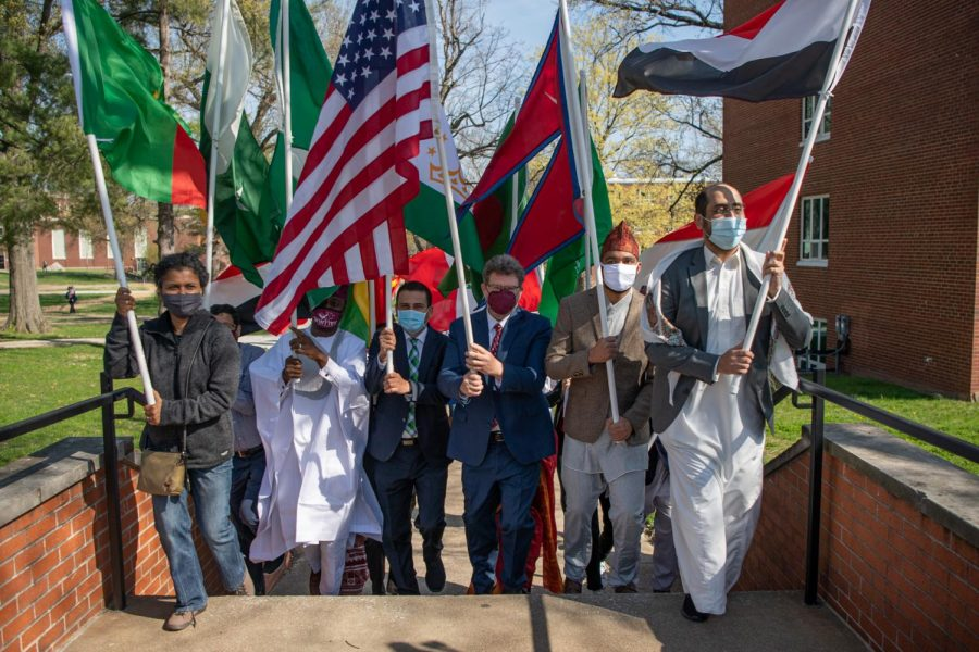 Andrew Carver, Executive Director of International Affairs, leads the parade around campus during the International Parade of Flags Monday, April 5, 2021 at SIU. The parade is the kick-off event apart of the International Fest 2021, a week long celebration for international students at SIU.