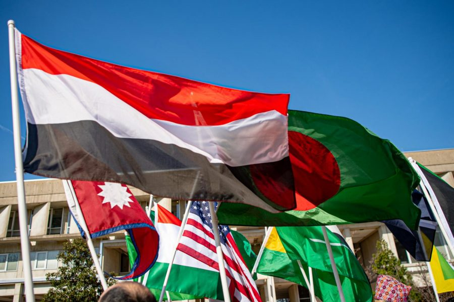 An assortment of flags from countries around the world fly high in the wind during the International Parade of Flags event, the kick-off event for the week long International Fest 2021 on Monday, April 5, 2021 at Faner Plaza at SIU.