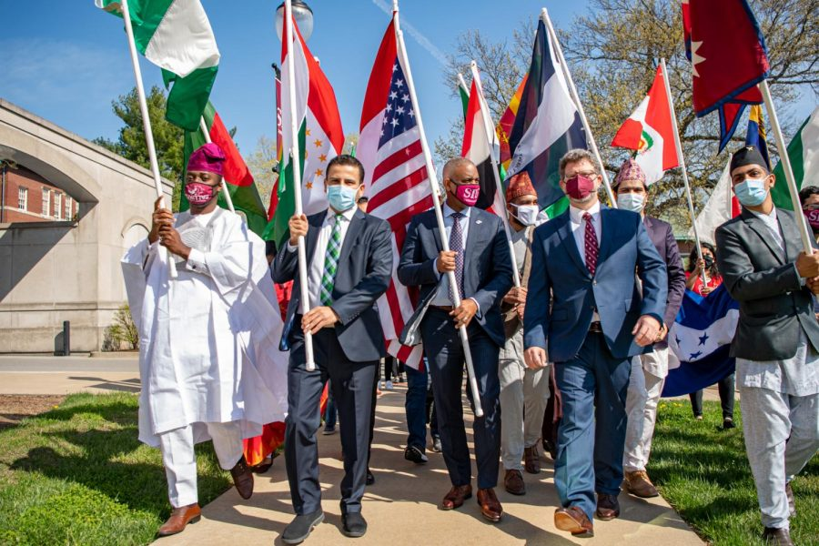 International Student Council President, Akmal Asoev, leads the parade along with chancellor Austin Lane, and  Executive Director of International Affairs, Andrew Carver, during the International Parade of Flags Monday, April 5, 2021 at the Student Service building at SIU. Jared Treece | @bisalo