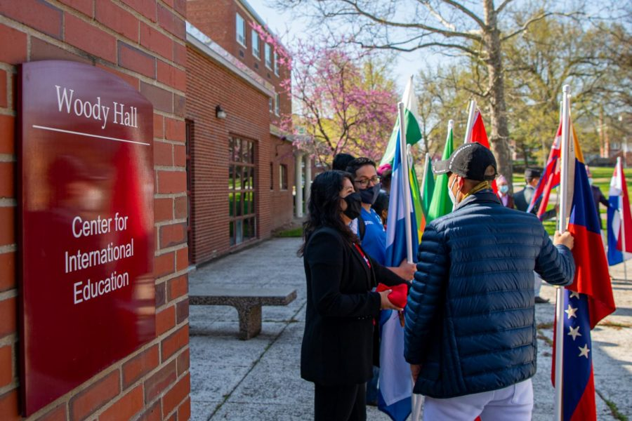 Parade participates wait outside the Center for International Educational at Woody Hall Monday, April 5, 2021 at SIU. The parade is the kick-off event apart of the International Fest 2021, a week long celebration for international students at SIU.