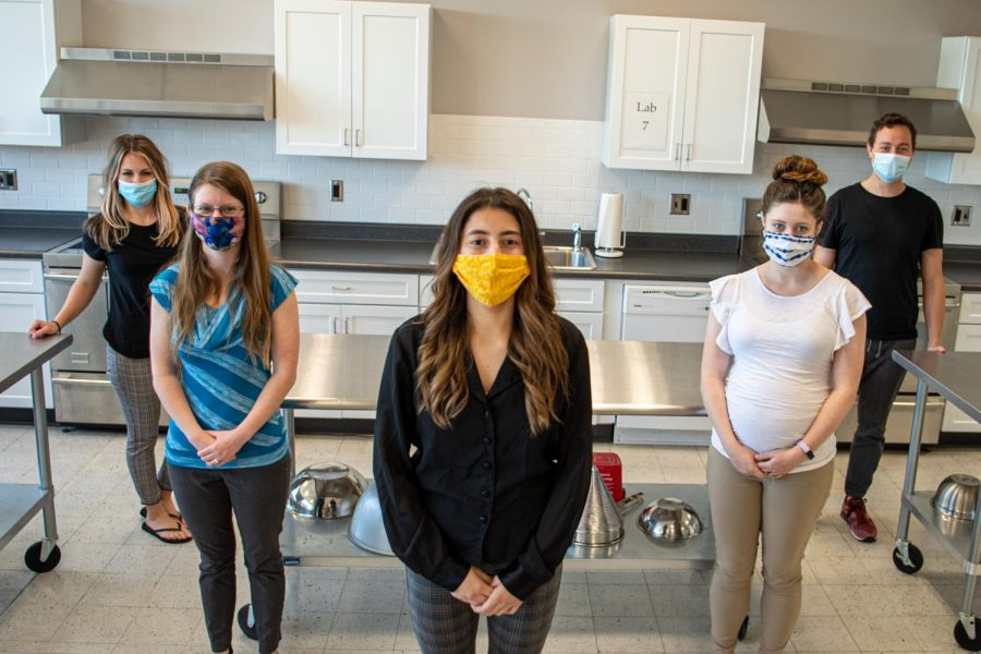 SIU Dietetic Interns Ashely Johnson, left,  Mariah Nelson, Arianna Bolivar, Melanie Tharp, and James Carmichael stand for a portrait on Thursday, April 15, 2021 in Quigley Hall at SIU. The Dietetic interns along with the undergraduates in Student Nutrition Academic Council (SNAC) have been producing a video series called Tasty Videos. These videos are made for the Murphysboro Food Pantry, to help show people coming into the pantry by showing quick cooking tutorials on how to make their meals more nutritious with things from the pantry.