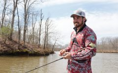 Thomas (TJ) Johns reels in a line March 31, 2021, at Kinkaid Lake in Jackson County, Ill. Johns said the Saluki Bassers are looking for new members and accept people of all experience levels in their club.