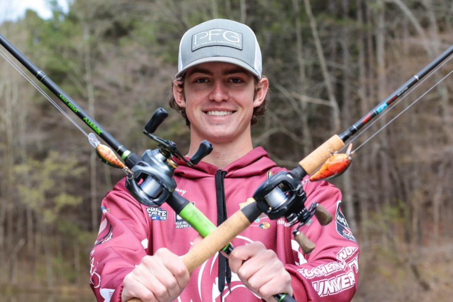 Andrew Novotney holds up his fishing rods March 31, 2021, at Kinkaid Lake in Jackson County, Ill. Novotney has been fishing with the Saluki Bassers for two years but has loved the sport since he was a kid.