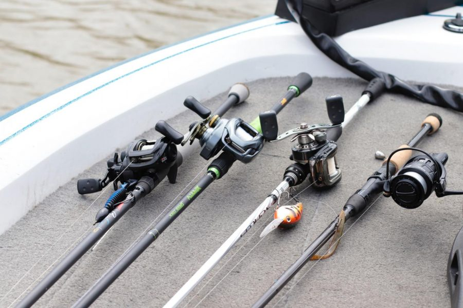 "Fishing rods lie on the boat March 31, 2021, at Kinkaid Lake in Jackson County, Ill. Thomas (TJ) Johns said that they hope to get more people involved in the fishing team. ""In the area, especially here in southern Illinois, bass fishing and fishing in general is huge,"" Johns said."