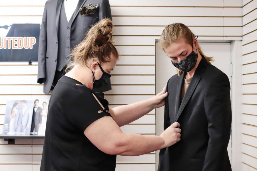Allison Spence fits a client for a tuxedo at Melise's Boutique April 3, 2021, in Marion, Ill. Melise's Boutique is a dress shop that provides formal wear as well as an embroidery service for the community.