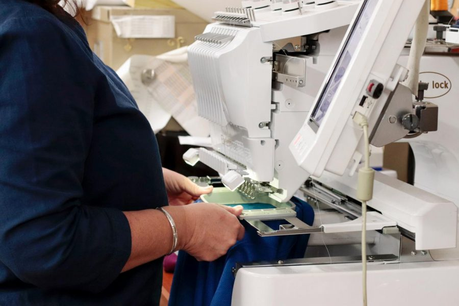 "Sheila Pepmiller embroiders a shirt at Melise's Boutique April 3, 2021, in Marion, Ill. Pepmiller has been embroidering with the boutique for eight years and said that one of the biggest challenges with COVID-19 was the inconvenience the restrictions were to the customers. ""It was easier just to come and get something, do it as a gift and take off and now it's not convenient like that,"" Pepmiller said."