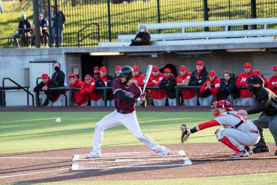 SIU outfielder, Brad Hudson (4), gets a hit during the third inning against ISU at Itchy Jones Stadium on March 2, 2021 in Carbondale, Ill.