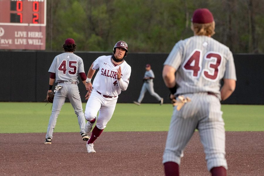 Phillip Archer (44) runs home during the game against Bellmore on April 10, 2021 at Itchy Jones Stadium in Carbondale, Ill.
