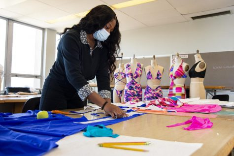 "Ebun Daley, a senior from Chicago, works on her senior fashion line Twisted Swim as part of the fashion design and merchandising program at Southern Illinois University in Carbondale, Ill. April 1, 2021. ""I think I've learned a lot in such a small amount of time, since I didn't enter the program until my sophomore year and I didn't even know how to sew,"" Daley said. ""Now that I'm able to do all of this, from not even being able to sew, I think is pretty good."" Daley hopes to mass produce her own swimwear line after graduation."