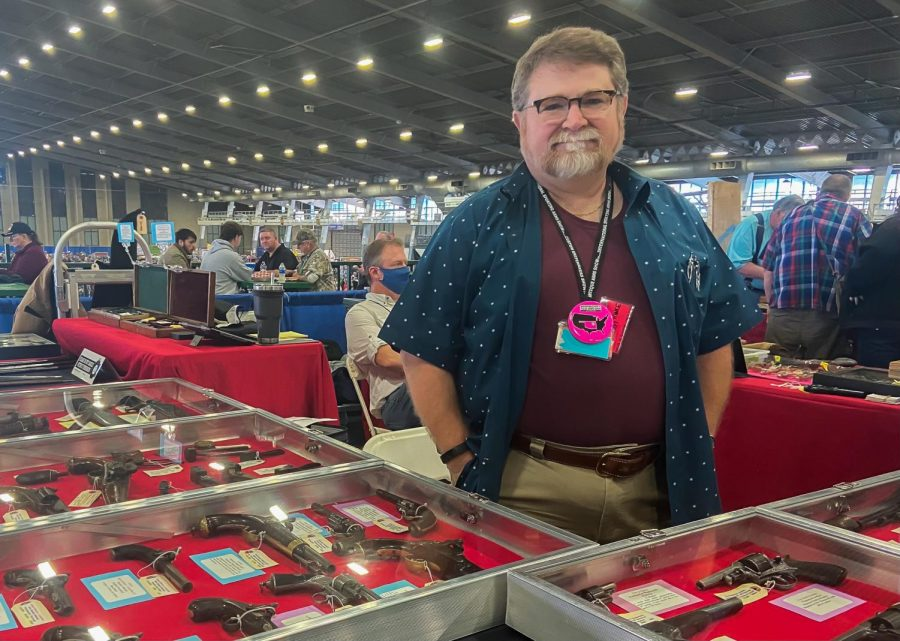 "Tim Prince, an antique and collectable arms dealer, stands behind his booth at the Wanenmacher's Arms Show April 10, 2021 in Tulsa, Okla. He said his passion for antique firearms began when he was younger and he would visit battlefields with his family. ""As a kid, my family's idea of vacation was going to historic sites, battlefields, stuff like that, so I kind of grew up with a real love of history, particularly American military history from the eighteenth and nineteenth century and so that's sort of what sparked my interest,"" Prince said."