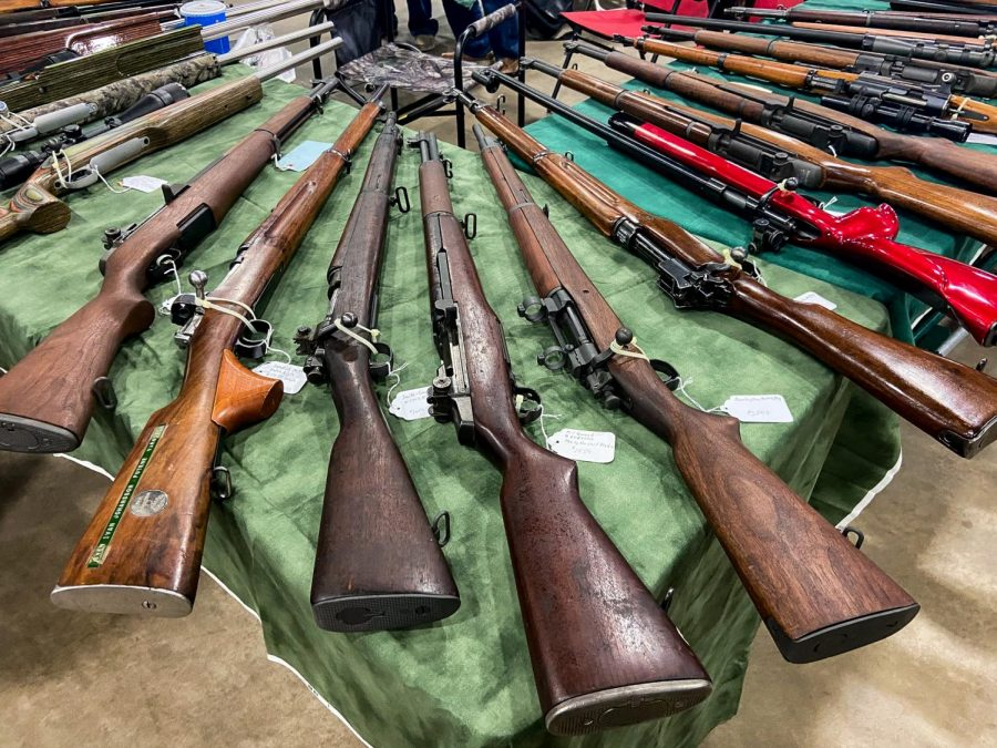 Guns line the tables at the Wanenmacher's Arms Show April 10, 2021 in Tulsa, Okla. The gun show had more than 4,000 tables and around 40,000 people in attendance over the two day event. The show has been going on for about sixty years and is run by the Wanemacher family.