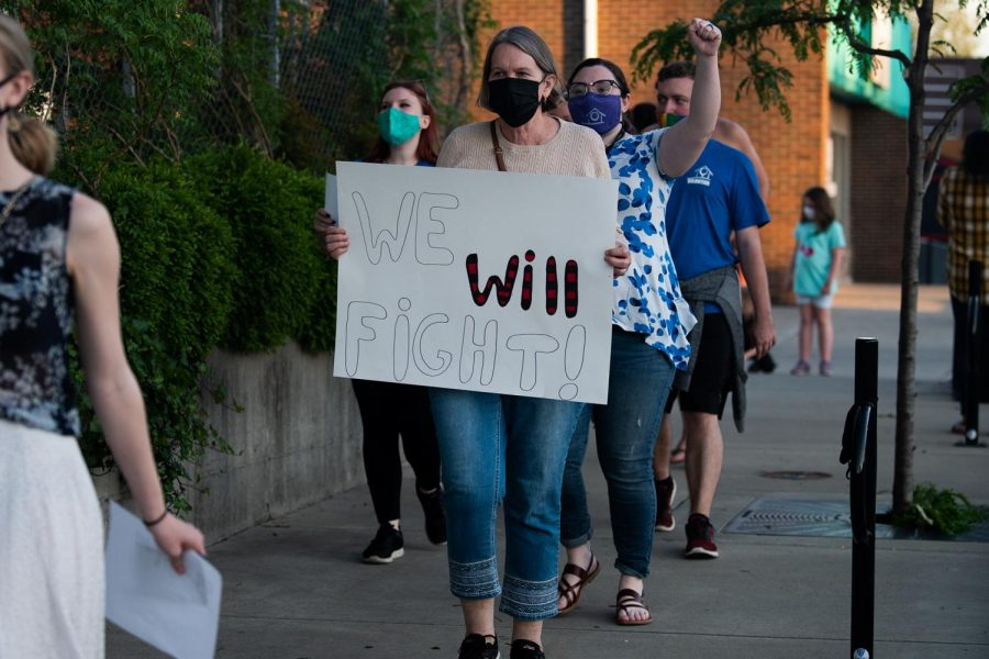 """Nel Battrell, a resident of Carbondale and one of the participants of the march, holds the placard during the """"Take Back the Night"""" event on Friday, April 30, 2021, at Carbondale, IIl. """"The program targets to bring awareness and educate the subject that the violence should be stopped,"""" Battrell said."""
