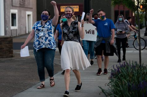 Activists participate in the vigil during the march on the stand with survivors of sexual violence on Friday, April 30, 2021, in Carbondale, Ill. The event was organized with the joint effort of staffs of The Women's Center and lasted for 2 hours starting at 7 p.m.
