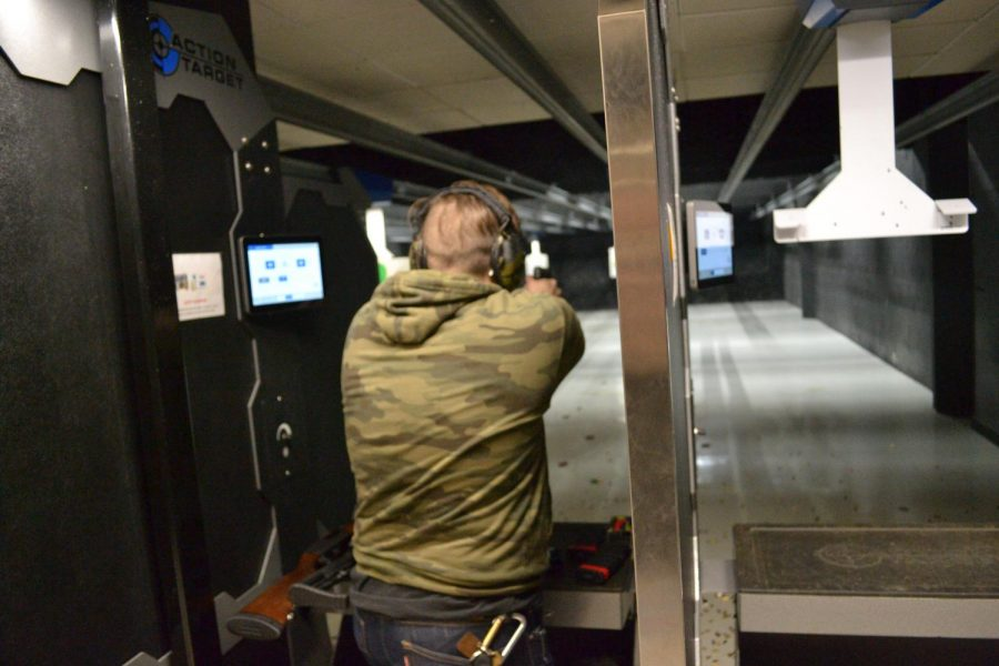 Seth M., whose name has been changed for the condition of anonymity, fires a handgun at a shooting range in the Chicago suburbs.