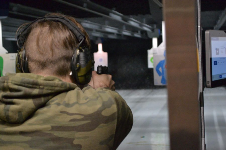 Seth M., whose name has been changed for the condition of anonymity, fires a handgun at a shooting range in the Chicago, Ill. suburbs.