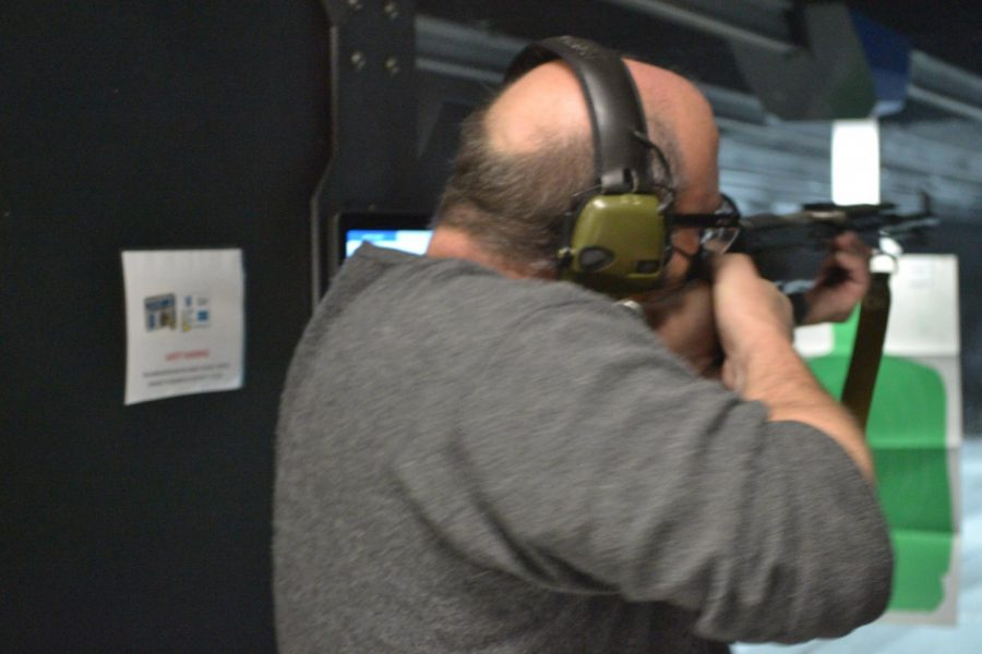 """Jack B. , whose name has been changed for the condition of anonymity, fires an SKS rifle at a shooting range in the Chicago, Ill. suburbs. """"It's the CR-ADR dirtbike of rifles,"""" Jack said."""