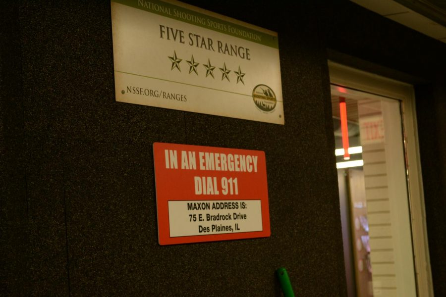 """Signs read """"FIVE STAR RANGE"""" and """"IN AN EMERGENCY DIAL 911' at a shooting range in the Chicago suburbs."""