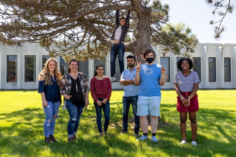 The Daily Egyptian spring 2021 photo staff pose for a group picture. From left to right: Leah Sutton, Sophie Whitten, Monica Sharma, Chris Bishop, Subash Kharel, James Allen and Madison Taylor.