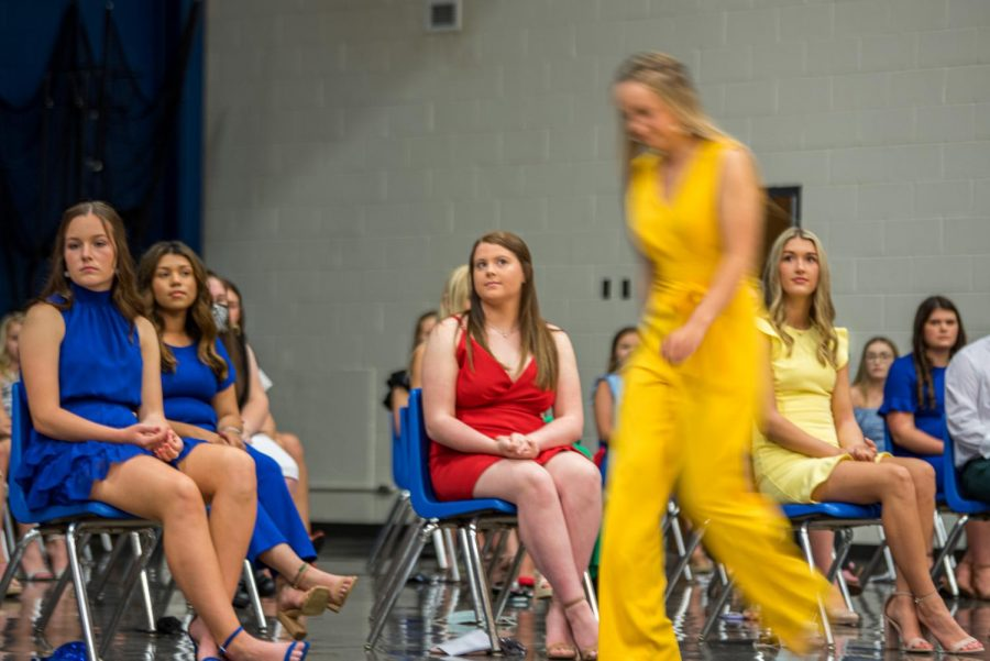 A high school senior walks up to accept a scholarship at the Scholarship Night Program at Marion high school. SIU will be delivering scholarships to southern Illinois high school on Monday, May 3, 2021 in Marion, Ill.