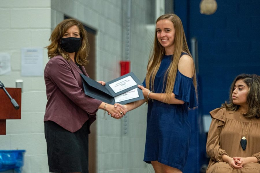 Taylor King, right, receives the Chancellor's Choice scholarship and the Salukis' Gold scholarship at the Scholarship Night Program at Marion high school on Monday, May 3, 2021 in Marion, Ill.
