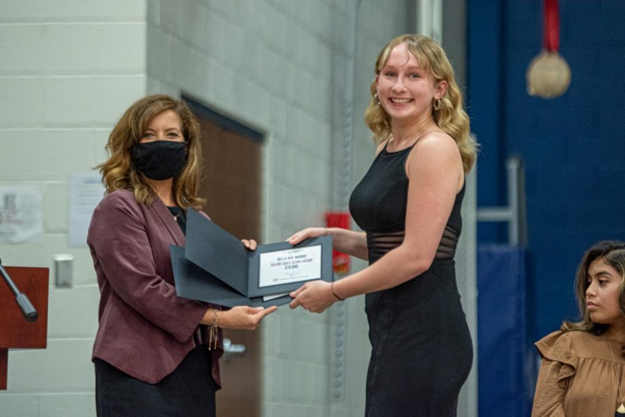 Bella Morris, right, receives the Chancellor's Choice scholarship and the Salukis' Gold scholarship at the Scholarship Night Program at Marion high school on Monday, May 3, 2021 in Marion, Ill.