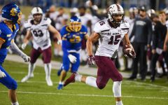 Javon Williams, Jr. (15) runs with the ball in the game against South Dakota State on Sunday, May 2, 2021 in Brookings, S.D. SIU went on to lose 26-31 against the Jackrabbits.