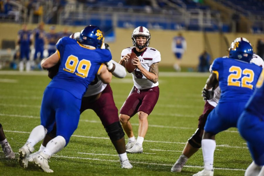 SIU quarterback, Stone Labanowitz (6), looks for the pass in the game against South Dakota State on Sunday, May 2, 2021 in Brookings, S.D. SIU went on to lose 26-31 against the Jackrabbits.