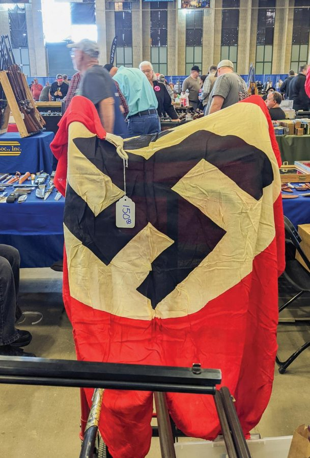 A flag with a swastika hangs on a stand at Wanenmacher's Tulsa Arms Show on April 10 and 11, 2021, at Expo Square in Tulsa, Okla.