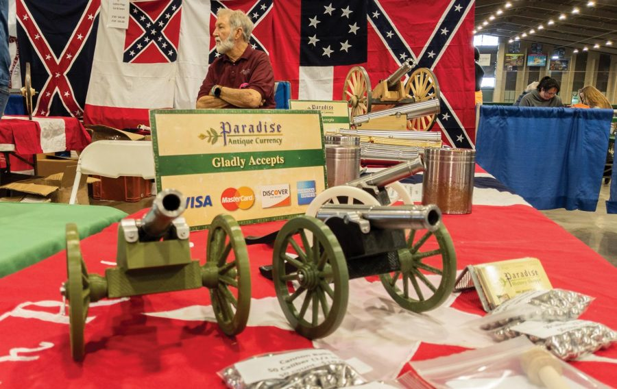 """A seller waits at his booth to sell miniature cannons at the Wanenmacher's Arms Show April 11, 2021 in Tulsa, Okla. """"We have various sizes of canons ranging from 3D printed to those made using Lathe machines, people use them during the independence day,"""" he said."""