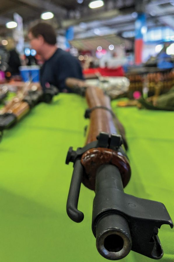 A rifle sits on a table at one of the booths at Wanenmacher's Tulsa Arms Show on April 10 and 11, 2021, at Expo Square in Tulsa, Okla.