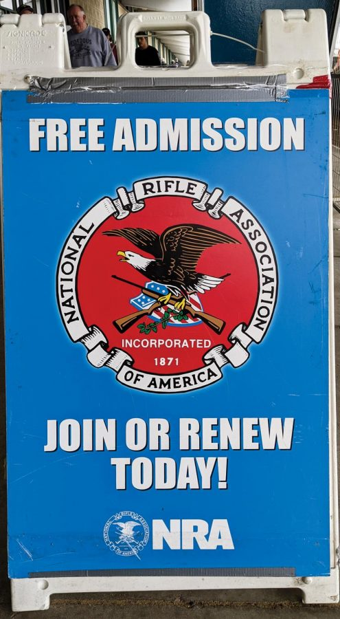 National Rifle Association of America (NRA) places an advertisement at the entrance with an offer to provide free admission at Wanenmacher's Tulsa Arms Show on April 10 and 11, 2021, at Expo Square in Tulsa, Okla. NRA is a gun rights advocacy group founded with an aim to advance rifle marksmanship.