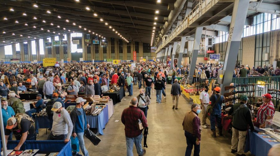 People enjoy browsing the collections at Wanenmacher's Tulsa Arms Show on April 10 and 11, 2021, at Expo Square in Tulsa, Okla. The show was crowded as people from different states traveled to attend.