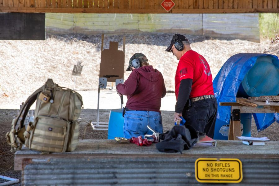 Mel Foster places her pistol into her holster at the Women's Shooting Club at the Tombstone Gun Range on April, 11, 2021. Before joining the group, Foster had taken a couple of home defense classes. Foster has been taking classes for several years and is a concealed carry license holder.