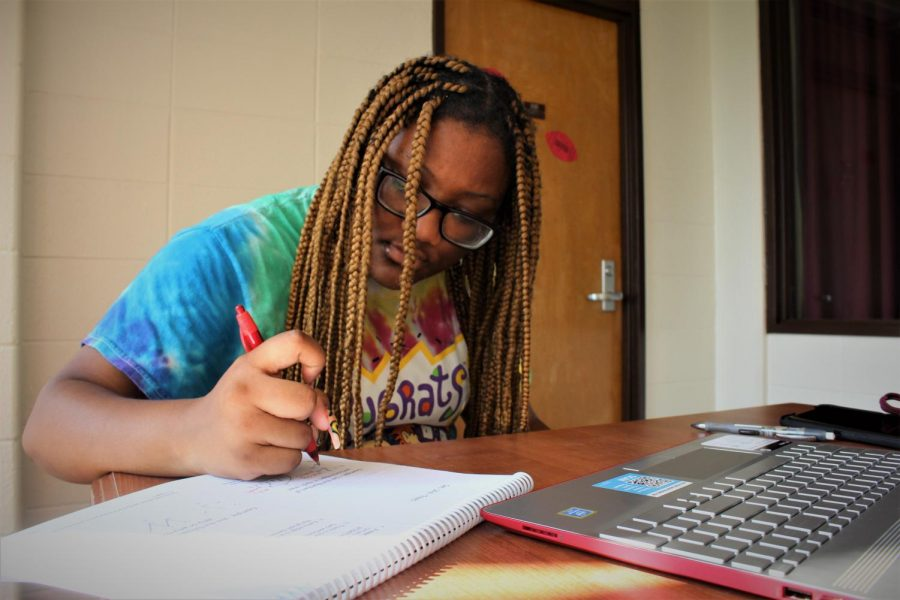 Jada Brown, a freshman majoring in cinema, does her homework in Kellogg Hall Aug. 27, 2021, in Carbondale, Ill.