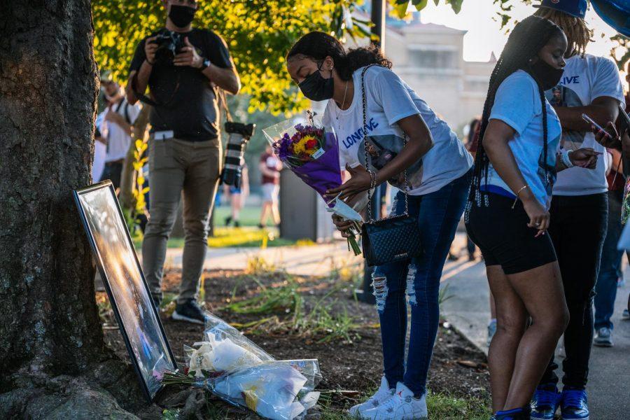 Shannas friend lays flowers on memorial Aug. 22, 2021.