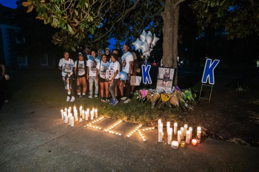 Keshannas friends stand beside her memorial Aug. 22, 2021 at Davies Hall at SIU.