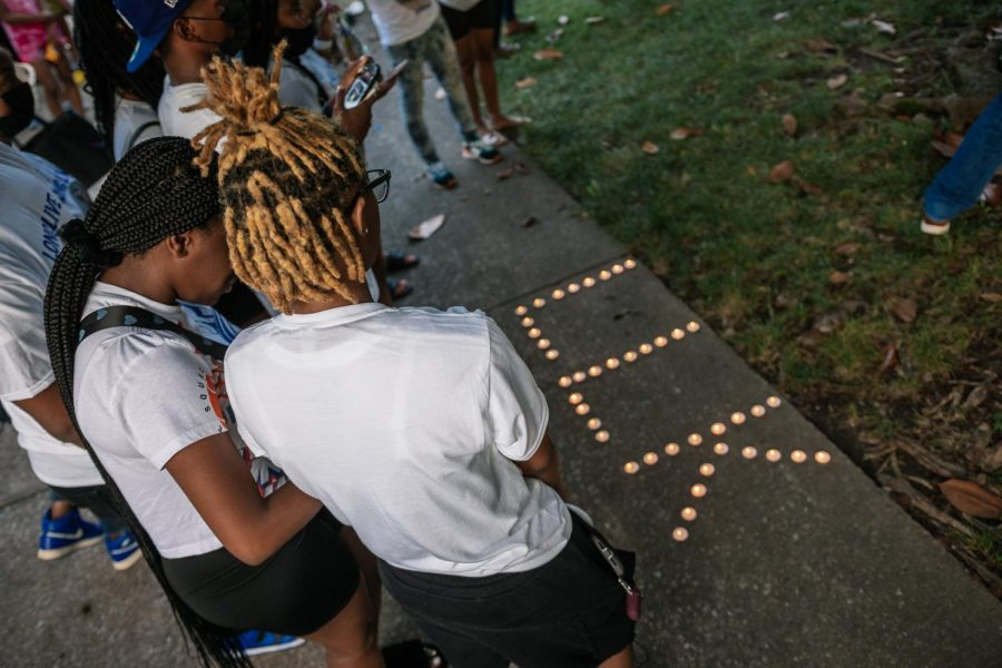Shannas friends mourn over her memorial at her prayer vigil Aug. 22, 2021 at Davies Hall.