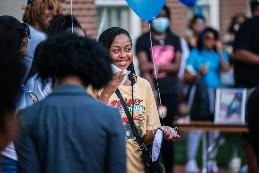 [Name] wipes away tears after giving remarks at Keshanna Shanna Jacksons vigil Aug. 22, 2021 at Davies Hall. [Name] was Shannas high school friend.