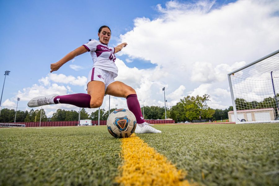 """SIU womens soccer player, Sam Dodd, poses for a photo. Dobb, a transfer player from University of Wisconsin-Milwaukee has joined the Saluki team for the 2021-2022 season. """"I thought it would be super cool as a chance to create history and build a really good program because its a new team. That stood out the most to me to turn this team into a winning culture,"""" said Dodd Sunday, Aug. 29, 2021 at Lew Hartzog Track and Field Complex at SIU."""