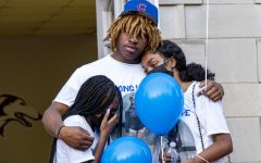 A group comfort each other during a vigil was held for Keshanna Jackson, a SIU freshmen who was shot and killed early Sunday morning.  The vigil was held in front of Davies Hall on Sunday, August 22, 2021 at SIU.