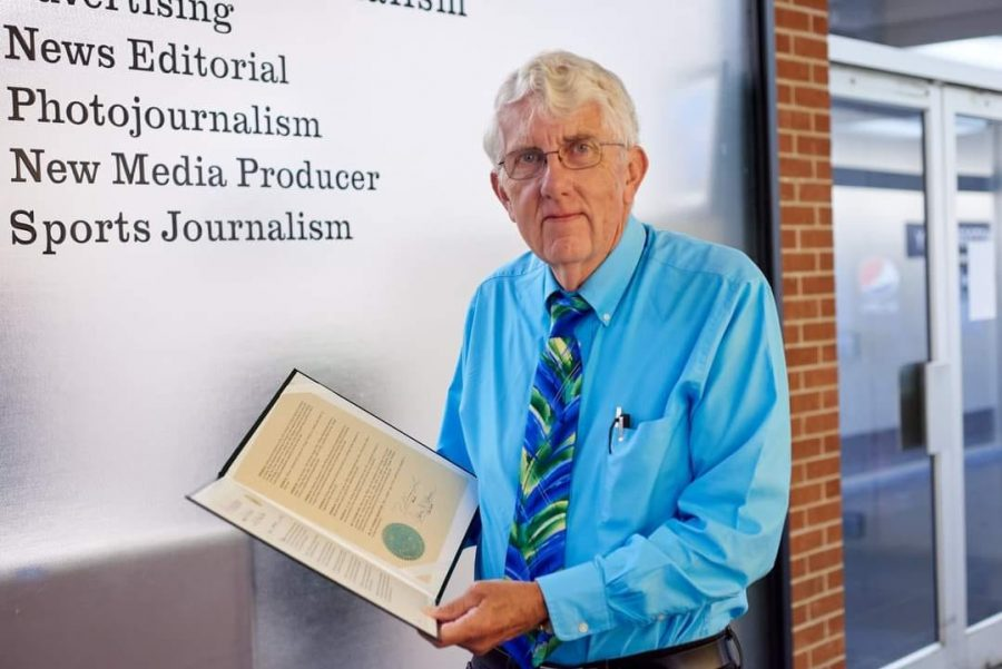 William Recktenwald posed for a picture at the SIUC School of Journalism before his retirement.