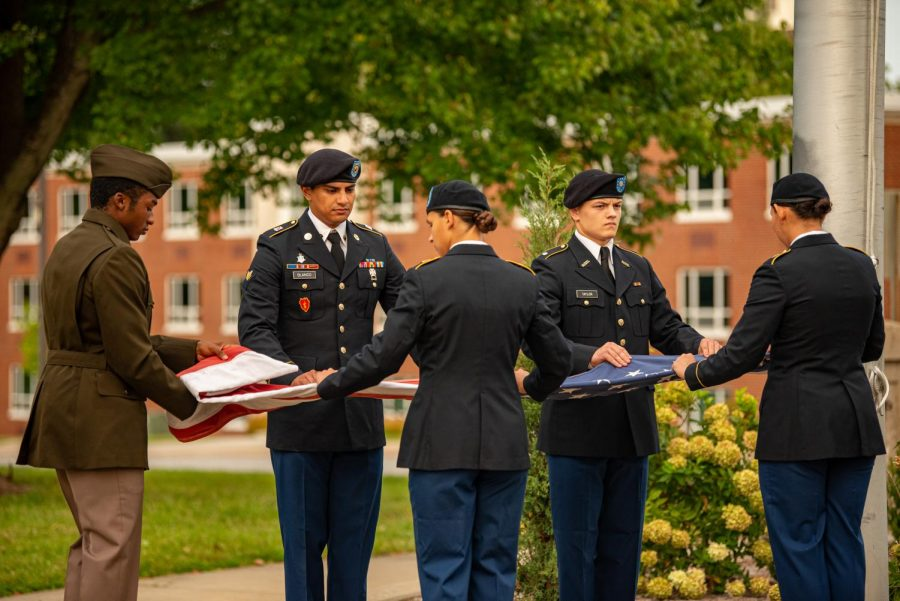Members of the Army and Air Force ROTC programs at SIU unfold the flag to be flown during the Patriot Day Ceremony held by the City of Carbondale to commemorate the 20th anniversary of the September 11th attacks Saturday, Sept. 11, 2021 at Altgeld Hall at SIU.
