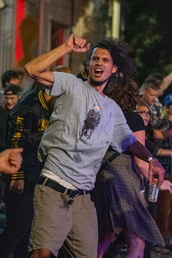 Mahdi Shafiei reacts during the Topomaka performance during the Lost Cross 35th anniversary event. Enjoying the life, said Shefiei while he was at performance on Friday, Sept. 24, 2021 at Hanger 9 in Carbondale, Illinois.