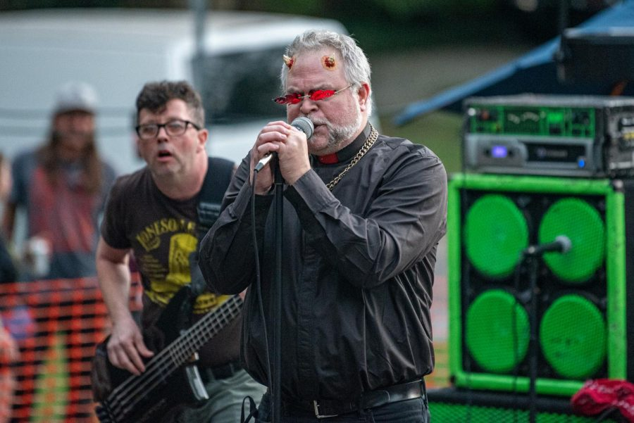 Frank Simpson, vocalist of Action Man, performance during the during the Lost Cross 35th anniversary event outside the Lost Cross House. The Lost Cross House, the oldest punk house venue in America, that sits between Elm and Beveridge was founded by Mikey Snot and Chris Cross in 1986. Lost Cross 35th anniversary was a two-day event that had musical performances at venues across the city on Saturday , Sept. 25, 2021 in Carbondale, Illinois.