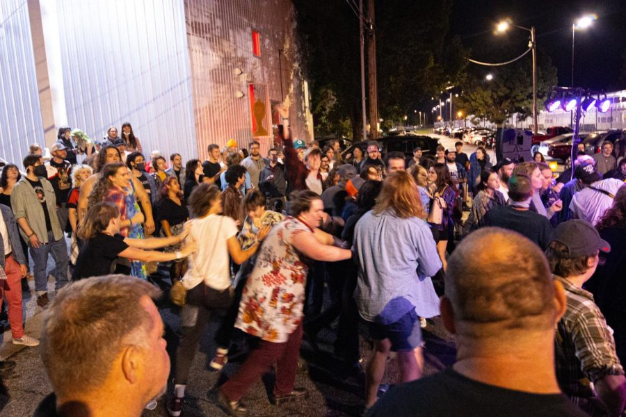 A small crowd in front of the stage, start moshing during a performance at Hanger 9 during the Lost Cross 35th anniversary event. The Lost Cross House, the oldest punk house venue in America, that sits between Elm and Beveridge was founded by Mikey Snot and Chris Cross in 1986. Lost Cross 35th anniversary was a two-day event that had musical performances at venues across the city on Friday, Sept. 24, 2021 in Carbondale, Illinois.