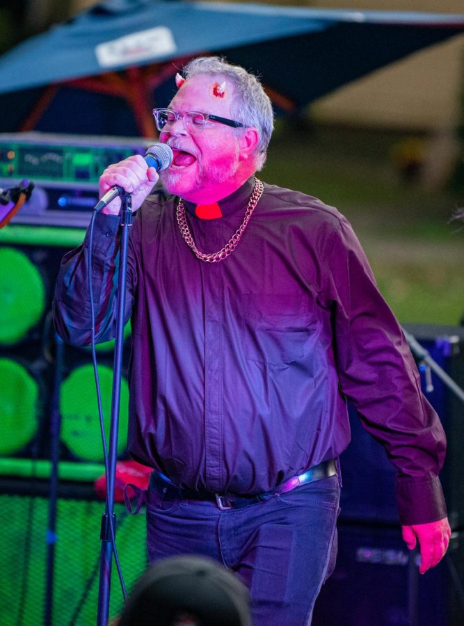 Frank Simpson, lead vocalist of Action Man, performs during during the Lost Cross 35th anniversary event. The Lost Cross House, the oldest punk house venue in America, that sits between Elm and Beveridge was founded by Mikey Snot and Chris Cross in 1986. Lost Cross 35th anniversary was a two-day event that had musical performances at venues across the city on Saturday, Sept. 25, 2021 in Carbondale, Illinois.