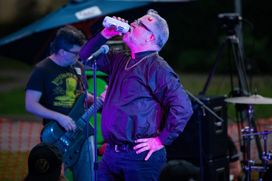 Frank Simpson, vocalist of Action Man, drinks a beer in-between songs during the Lost Cross 35th anniversary event. The Lost Cross House, the oldest punk house venue in America, that sits between Elm and Beveridge was founded by Mikey Snot and Chris Cross in 1986. Lost Cross 35th anniversary was a two-day event that had musical performances at venues across the city on Saturday, Sept. 25, 2021 in Carbondale, Illinois.