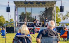 Radio Free Honduras performs music to a field of concert attendees Sept. 24, 2021 at the Off the Rails concert series in Carbondale, Ill.