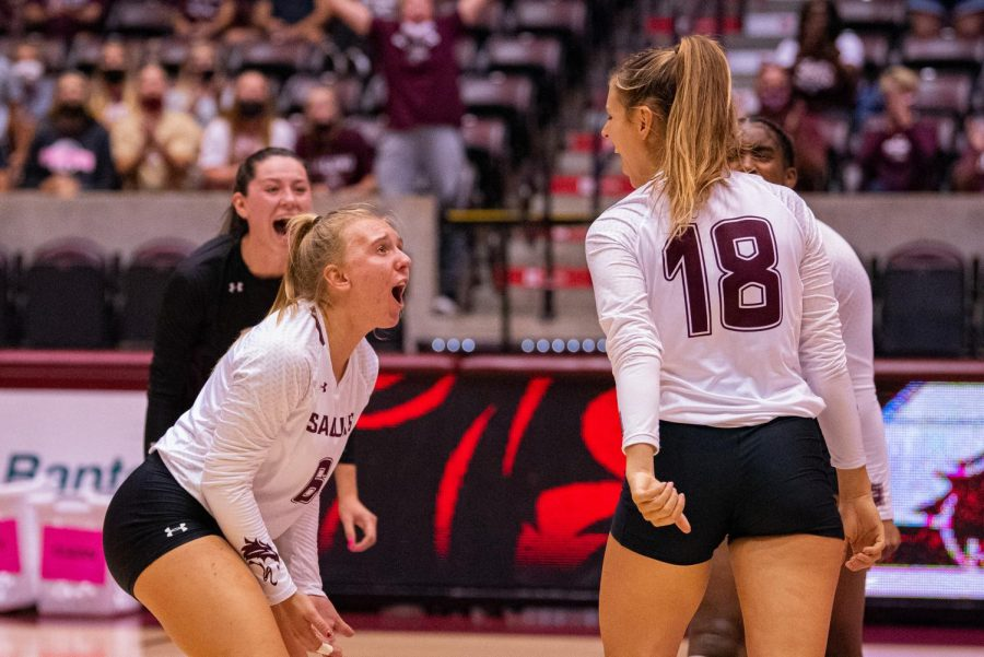 Freshman setter Anna Jaworski, left, reacts after a scoring play by Tatum Tornatta, right, during SIUs 3-2 comeback win against UT Martin during the Saluki Bash tournament on Friday, Sept. 3, 2021 at the Banterra Center at SIU.